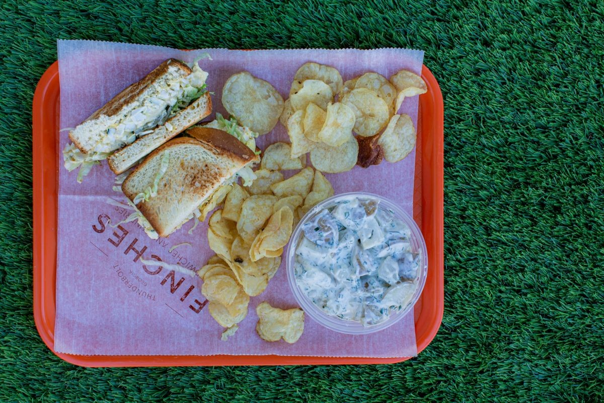Egg Salad Sandwich with chips and potato salad. - LINDY MOODY