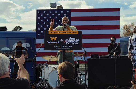 Acclaimed hip-hop artist Common appears at a Garden City rally supporting the U.S. Senate campaigns of Georgia Democrats Jon Ossoff and Raphael Warnock on Dec. 19. - TAYLOR CLAYTON/CONNECT SAVANNAH