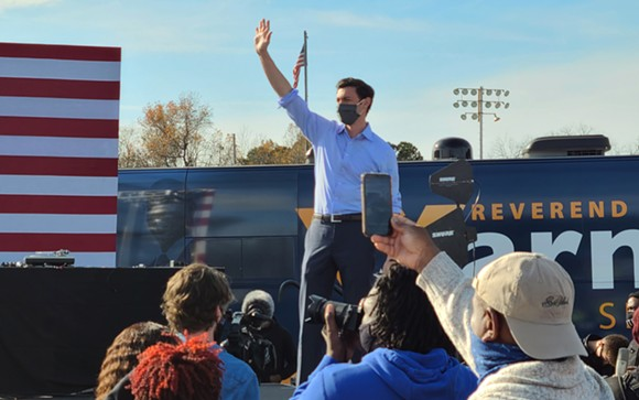 Georgia Democrat Jon Ossoff waves to the crowd at a rally to boost his U.S. Senate campaign, appearing along with Raphael Warnock and hip-hop artist Common, in Garden City on Dec. 19. - TAYLOR CLAYTON/CONNECT SAVANNAH