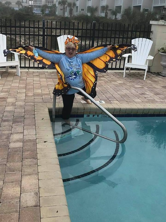 Kathy Black-Dennis with Friends of the Tybee Theater demonstrates how to participate in the Jan. 1, 2021 virtual Polar Plunge. - COURTESY OF THE TYBEE POST THEATER