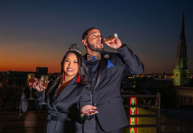 A couple welcomes 2021 while partying with face masks at Savannah's Peregrin rooftop bar. - ADRIANA IRIS BOATWRIGHT