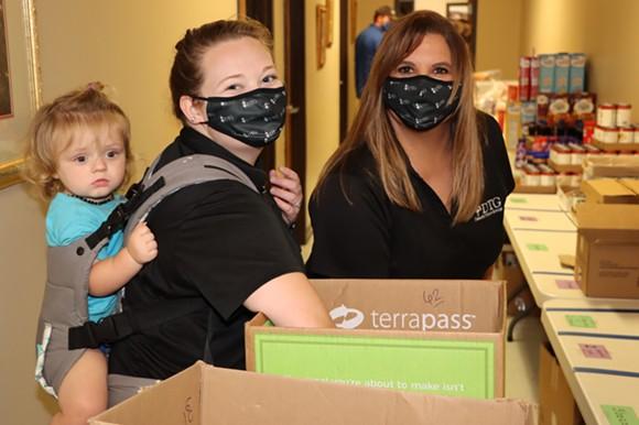 Employees of the Dewitt Tilton Group lend a helping hand. - COURTESY OF THE DEWITT TILTON GROUP