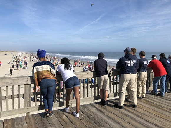 Spectators watch the New Year's Day waders from Tybee Island's pier. - NICK ROBERTSON/CONNECT SAVANNAH