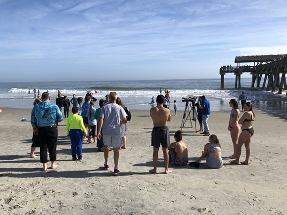 Hardy waders dry off a few minutes after rushing into the Atlantic on New Year's Day at Tybee Island. - NICK ROBERTSON/CONNECT SAVANNAH