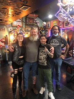 Don Caskey hangs out with the crew at Savannah's Tramp Art Studios. - COURTESY OF TRAMP ART STUDIOS