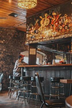 The ever-popular bar at Bayou Cafe. - LINDY MOODY
