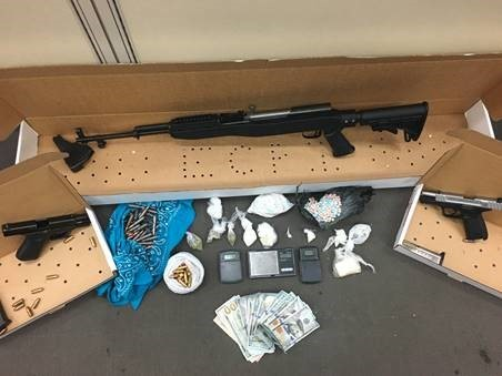 Guns and contraband seized in the investigation to drug activity on Savannah's Reynolds Street. - COURTESY OF THE SAVANNAH POLICE DEPARTMENT