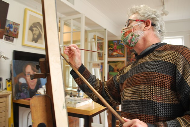 Alan Kindler works on a painting in progress in his studio on the upper level of Cedar House Gallery. - NOELLE WIEHE/CONNECT SAVANNAH