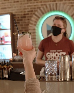 A patron raises their glass to Cory Reuter, bar manager at Ghost Coast Distillery. - PHOTO COURTESY OF GHOST COAST DISTILLERY