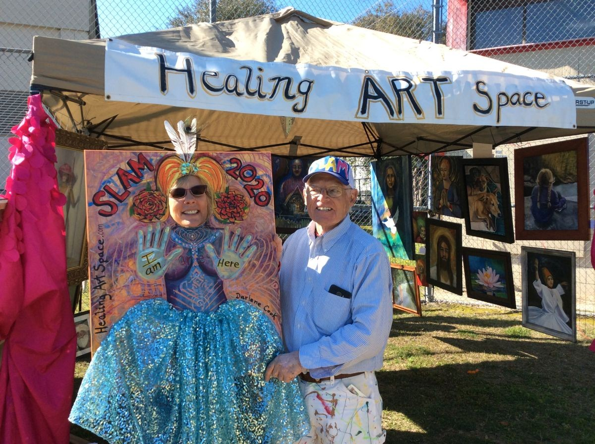 Darlene Cook, artist, displays art at ther booth with Charles Ellis, SLAM founder. - PHOTO COURTESY OF SLAM