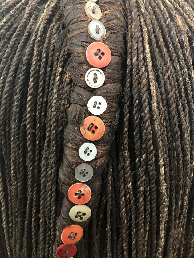 A display of intricately braided hair on view in the Savannah African Art Museum's new 'ROOTS' exhibit, honoring diverse hair cultures in varied African societies. - PHOTO COURTESY OF SAVANNAH AFRICAN ART MUSEUM
