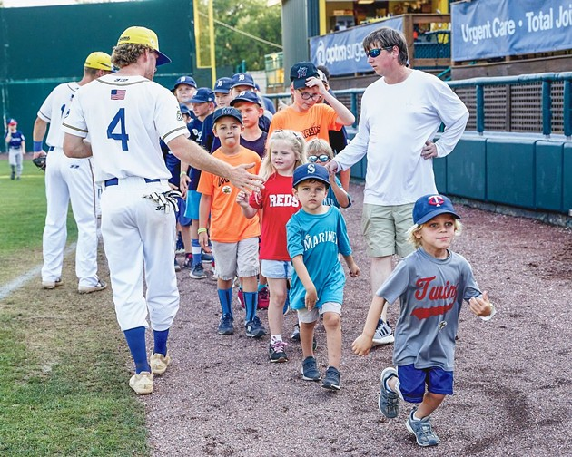 Fans sport sports jerseys from all over the country as they meet Savannah Bananas players on the field at Grayson Stadium. - PHOTO COURTESY OF THE SAVANNAH BANANAS