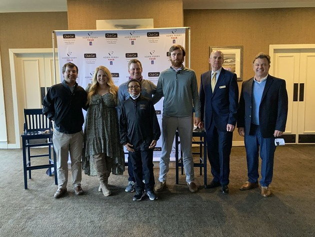 """The Landings Club staff, Korn Ferry Tour members and Club Car representatives, along with the tournament's """"kid correspondent"""" gather at Deer Creek for an announcement. - PHOTO BY NOELLE WIEHE"""