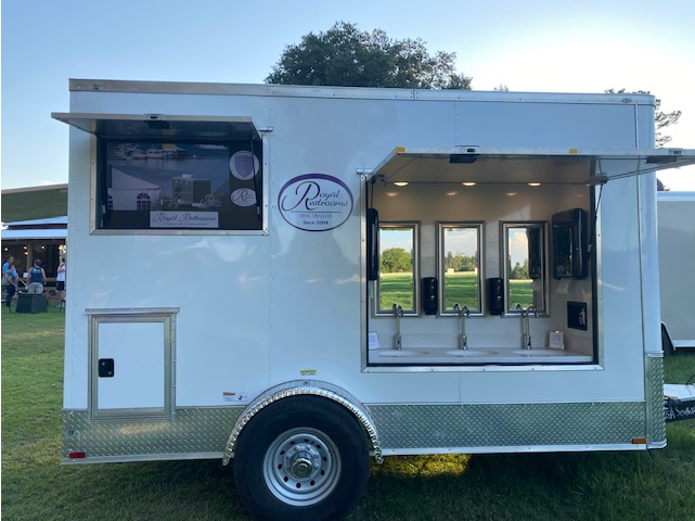 The motion hand washing station called the Sink Trailer by Royal Restrooms is placed at an event to assist guests with their handwashing needs. The Sink Trailers come with a custom painted steel frame with locking diamond plate utility doors which house the water heater and pressure pump. - PHOTO COURTESY OF ROYAL RESTROOMS