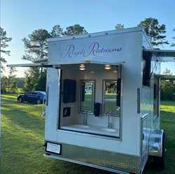 A portable Sink Trailer is placed at an event for use by guests. Royal Restrooms has many different portable restrooms to choose from to make guests' personal needs fit the special occasion, from small to large events like weddings, festivals and corporate events. - PHOTO COURTESY OF ROYAL RESTROOMS