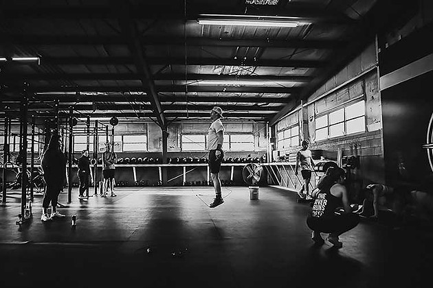 Members of River Drive Crossfit workout in the facility in Thunderbolt. - PHOTO COURTESY OF RIVER DRIVE CROSSFIT