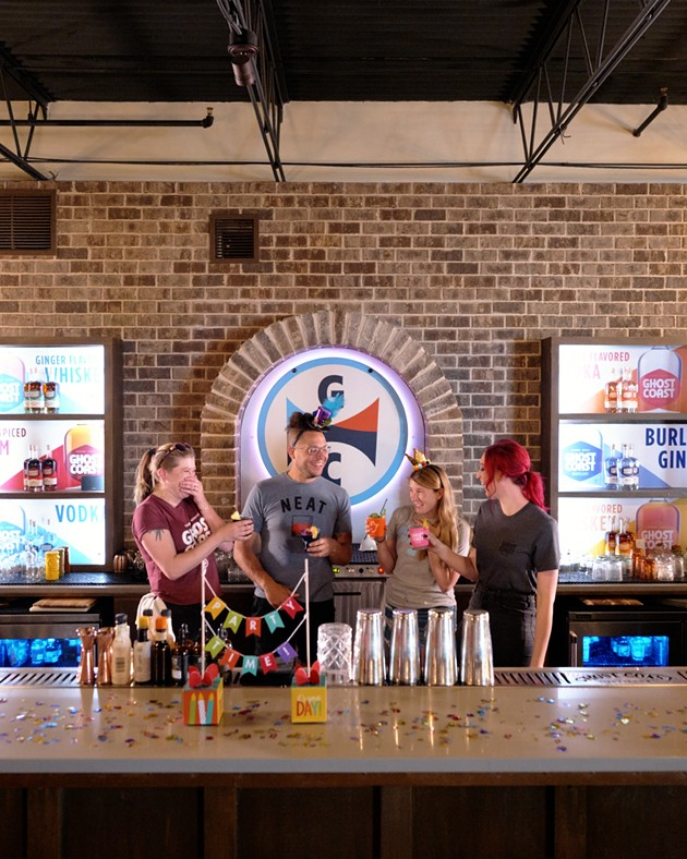 Ghost Coast Distillery team members, Cory Reuter, DJ Brown, Sara Fullerton and Olivia Mayday, celebrate the distillery's fourth birthday ahead of their big party at their location on Indian St. - PHOTO COURTESY OF DEVIN OLSON MEDIA