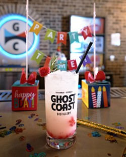 Bartenders at Ghost Coast Distillery serve a drink among confetti as the distillery team prepares to celebrate with locals for their fourth birthday party in Savannah. - PHOTO COURTESY OF DEVIN OLSON MEDIA