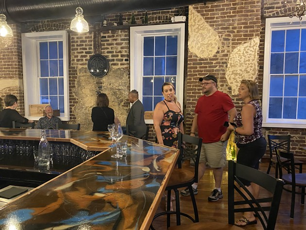 Savannah wine enthusiasts attend the quiet opening night of the newest wine bar, 208 Wine Bar, located at 208 E. Bay St. The riverfront bar will intorduce wine flights and intend to expand their wine list. - PHOTO BY JESSE BLANCO