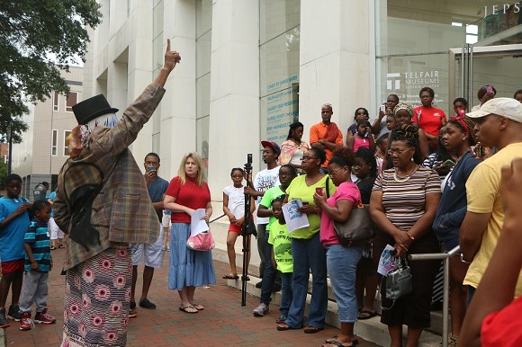 """Savannah tradition dictates that the commencement of Juneteenth festivities begin with a libation ceremony led by Dr. Amir Jamal Touré on the steps of the Jepson """"to invoke the call of the ancestors."""""""