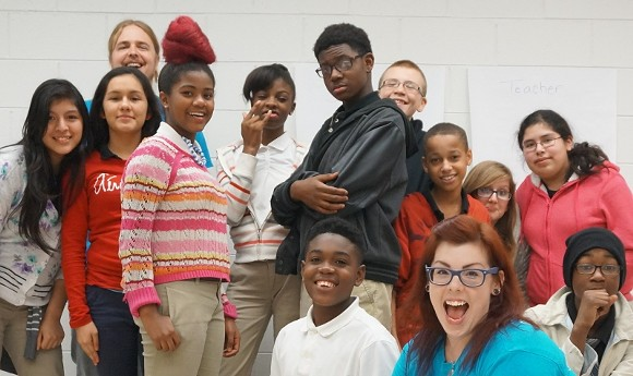 Group shot of the Deep Center workshop at Mercer Middle School, with André Massey at center. - PHOTO BY MELANIE GOLDY