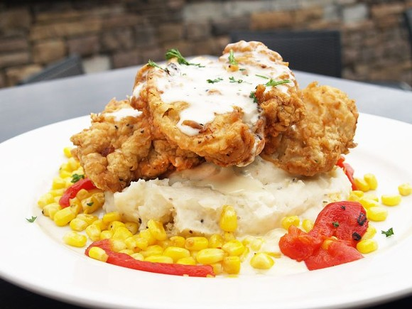 Executive chef Lawrence Rice borrows his recipe for fried pork chops and garlic corn succotash from his grandmother, serving it up with seasoned mashed potatoes.
