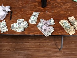Seized cash at concert.