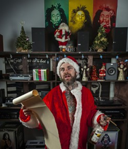 James May of Black Tusk is Bad Santa; suit courtesy of Justin Kent and JinHi Soucy Rand; shot on location by Geoff L. Johnson at Rody's Music downtown - PHOTO BY GEOFF L. JOHNSON