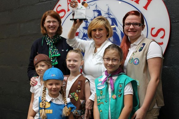Savannah Coffee Roasters' Lori Collins (center) was presented the trophy for the Girl Scout Cookie Culinary Competition last year by the Girl Scouts of Historic Georgia CEO Sue Else (left) and intends to defend the sweet title. - PHOTO COURTESY OF GSHG