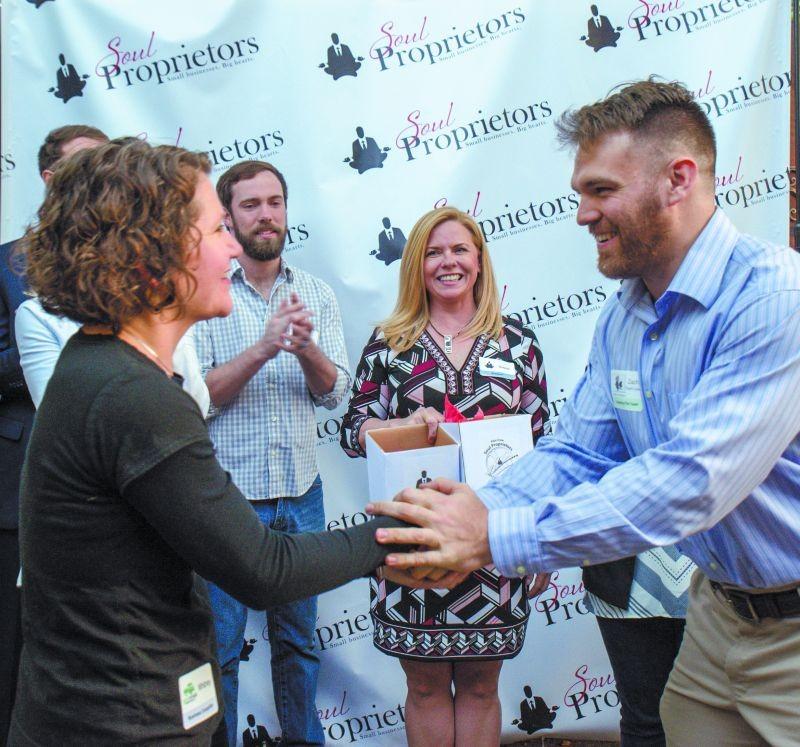 Green Truck Pub's Whitney Yates (l.) meets Zachary Burke of Ardsley Park Productions as Soul Proprietors founder Debbie Brannigan looks on.