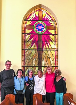 Senior yoginis Alan and Phyllis Boulton, Betsy Strong, and Georgette Battleand practice all kinds of asanas as the Saints & Sages most Wednesdays at Butler Presbyterian Church