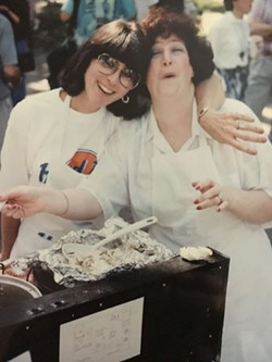 """Volunteers Marcia Berens and Ava Gottlieb back in 1996, when the food festival was called """"The Hard Lox Cafe."""" - COURTESY OF MICKVE ISRAEL"""