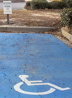Since changed, this handicapped space once had a reserved sign for the superintendent.