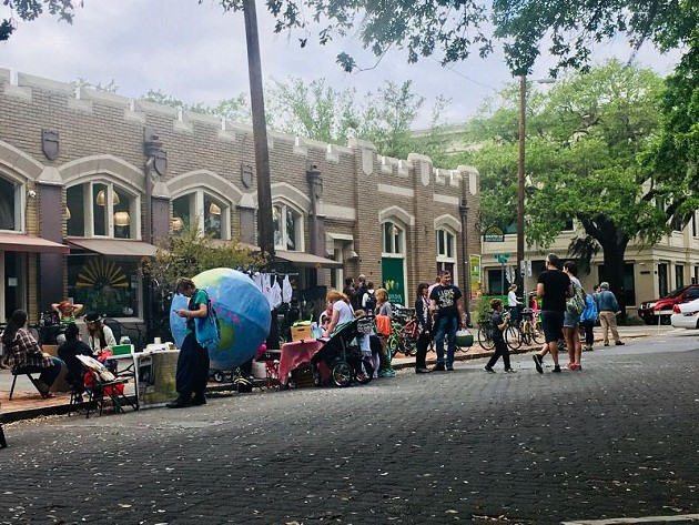 Park Ave between Drayton and Bull streets was closed to cars, but not to people, during the Earth Day Festival in Forsyth Park. People strolled, pedaled, talked, and enjoyed the street. Cars were excluded from one block, but the world did not end.