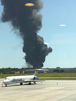 A citizen photo of the crash in the background. - LEE TONE/LMFT