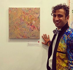 The artist with his work.