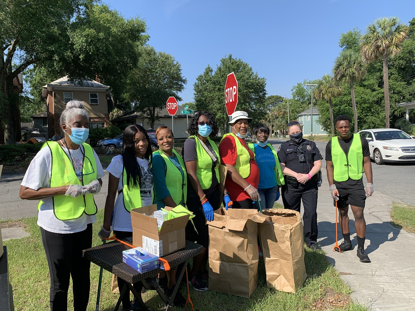 """Community members clean their neighborhoods as part of the """"2 Legit to Lit"""" Campaign."""