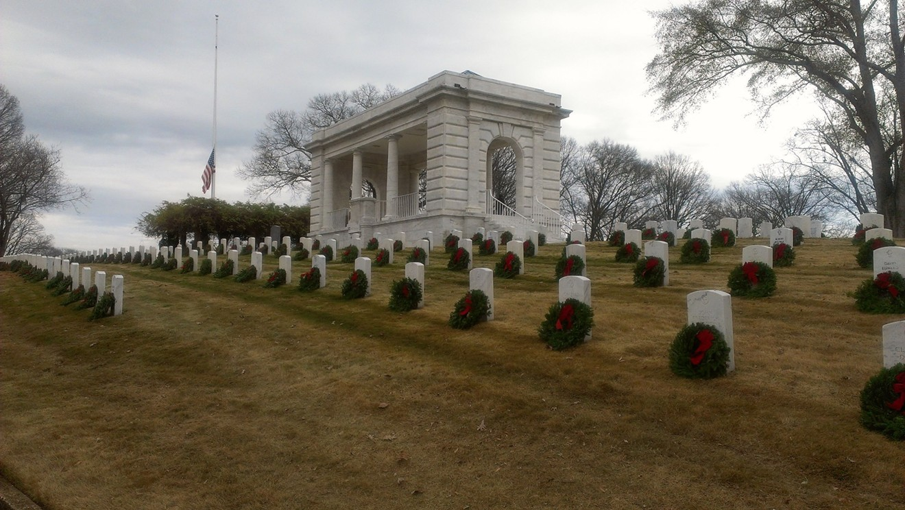 The American flag and a Prisoner of War/Missing in Action flag wave over the Marietta National Cemetery on a previous year's Wreaths Across America Day in December.