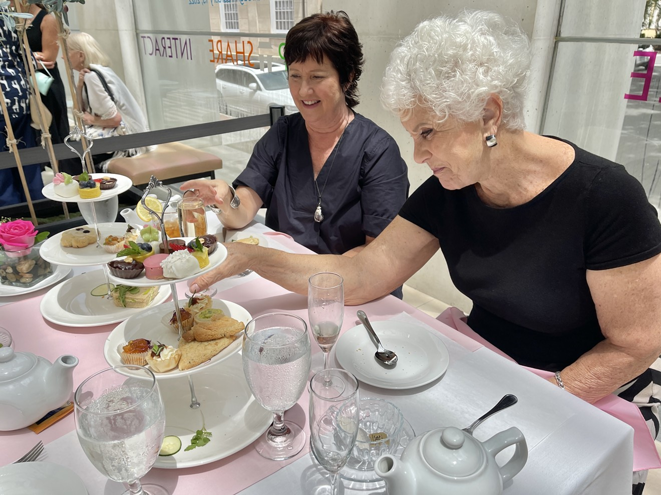 Guests help themselves to some tea time snacks during Afternoon Tea at Joe's at the Jepson July 21 at the Telfair's Jepson Center for the Arts.