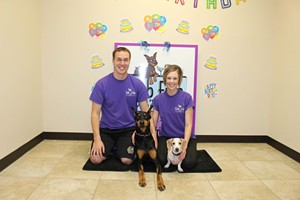 Ashley with her husband Denver and their two pups DeSoto and Cruiser