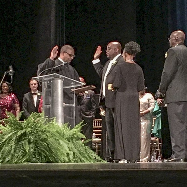 Mayor Johnson being sworn in by Judge John E. Morse