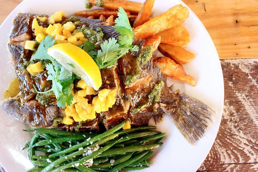 Dinner is served: Crispy Scored Flounder with Rakies Island sauce and chimichurri.