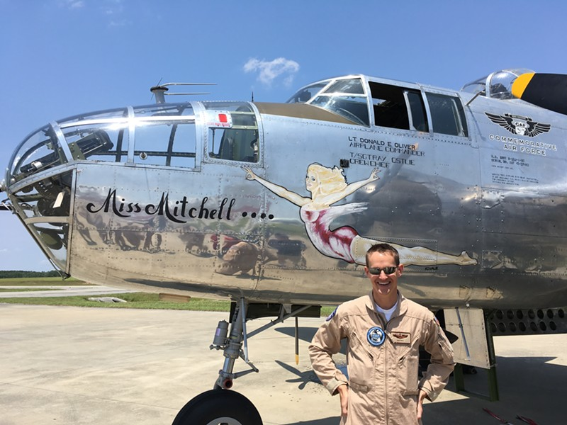 Pilot In Command Matt Quy, U.S. Air Force and Commemorative Air Force, with 'Miss Mitchell.' The nose art is by the original artist. - PHOTO BY JIM MOREKIS