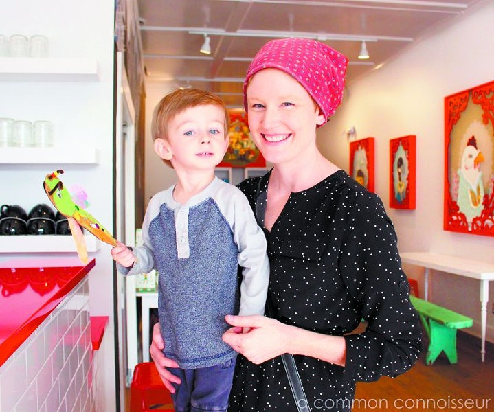 Owner of the Foxy Dynasty, Jennifer Jenkins, enjoys the new space with her son, Ison.