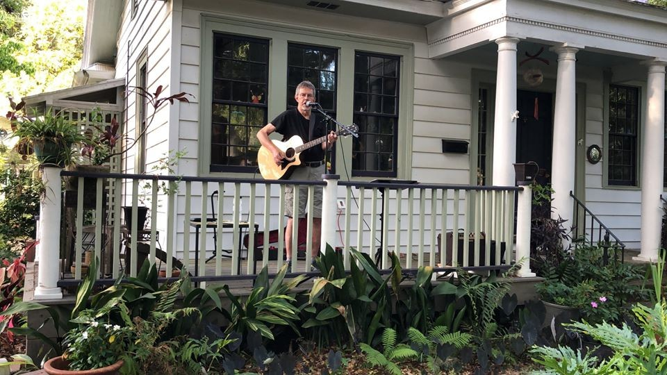 Pat Mooney performs from his front porch.