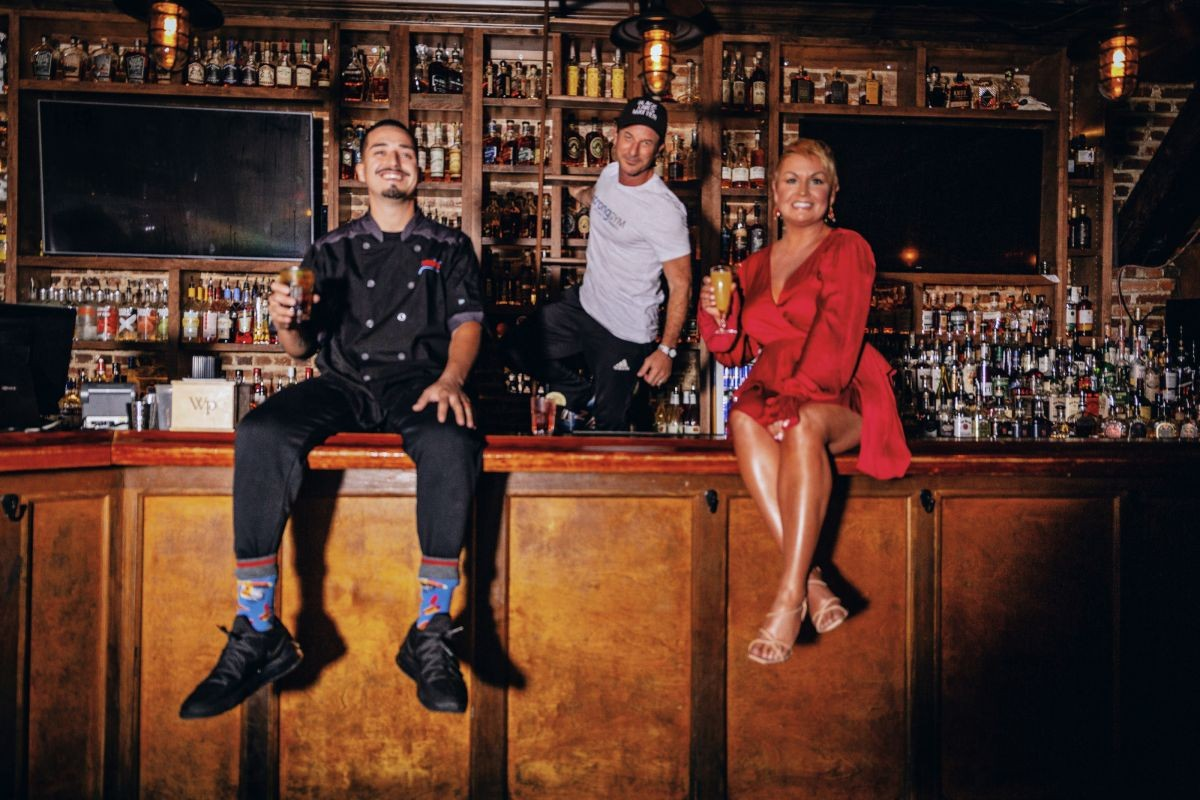 Alternate photo from this year's cover shoot, with (l-r) Chaz Ortiz (Chazito's Latin Cuisine) Mark Lebos (Strong Gym), and Kris Allred (WSAV), at Congress Street Social Club.