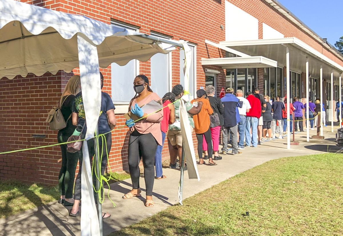 Chatham County residents wait in line to vote early at the Board of Registrars office in the Nov. 3 general election.