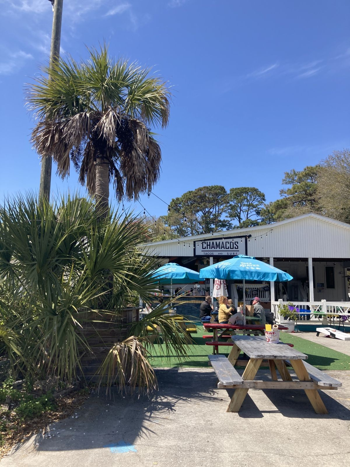 Patrons gather March 23 for lunchtime tacos at Chamacos Tacos and Surf. The business reopened with more retail and room for live music recently.
