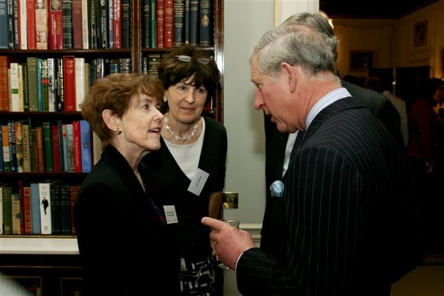 Stuttering Foundation President Jane Fraser speaks to fellow colleagues inside of a library where her material can be found.
