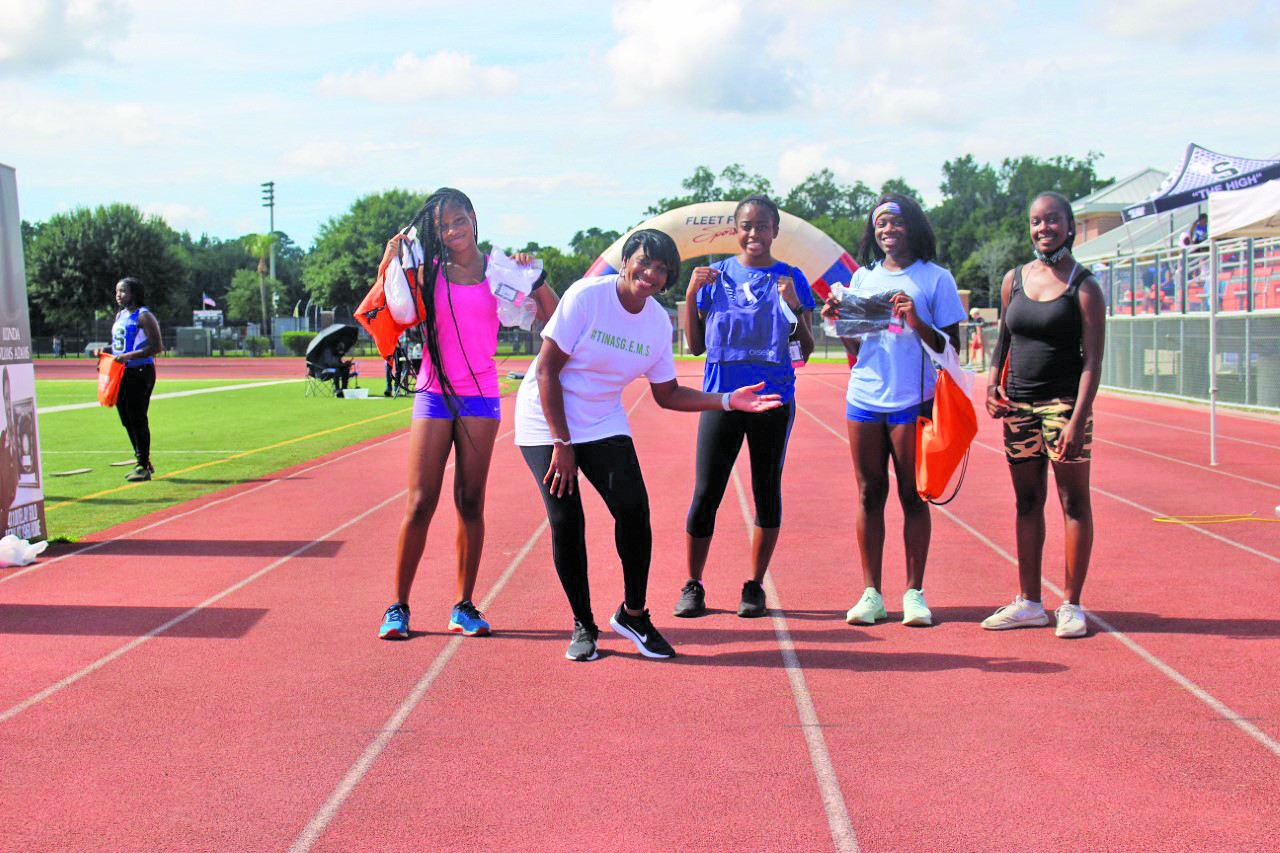 WSAV News Anchor Tina Tyus-Shaw (second from left) with students from Woodville-Tompkins High School. The local celebrity donated sports bras in honor of Olympic legends like her aunt, teaching them about the importance of self care while being an athlete.